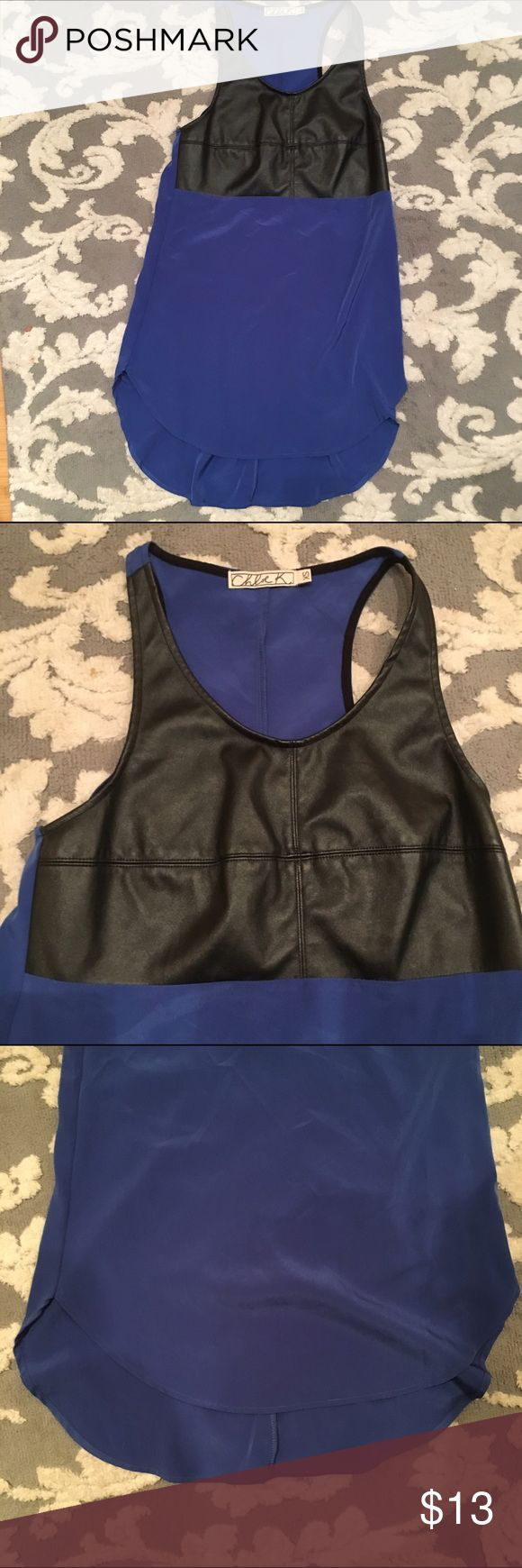 Leather and royal blue long tank top Racer back long tank top, with leather on the bust. Very moveable and can fit bigger than an XS depending how long you prefer it to be. Chloe K Tops Tank Tops