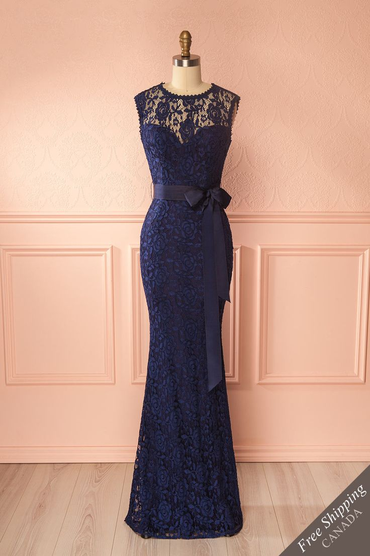 Francia Navy #boutique1861 / Lace lends itself easily to all celebrations and elegant events; this long ravishing dress will give you a soft and undeniably distinguished look. The mermaid cut highlights your silhouette by hugging your curves and flaring gracefully to the floor. Add pearls around your neck and on your ears and you're sure to make a majestic entrance!