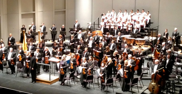 CCSA singers at the conclusion of the Liszt: Dante Symphony with the San Antonio Symphony and Maestro Ken-David Masur.