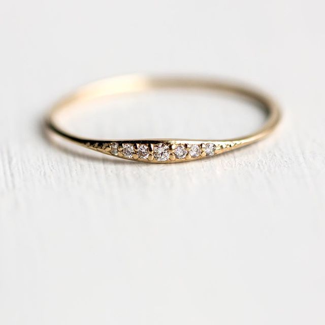 Our sweet and sparkly diamond Tiny Line band in 14k yellow gold Available at our…