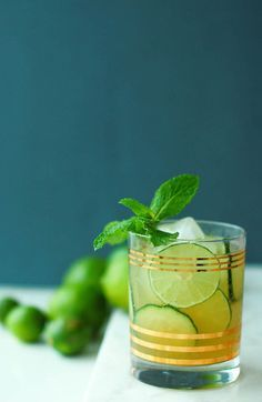 luck of the irish whiskey rickey cocktail — made with whiskey, lime, cucumber, and mint soda water