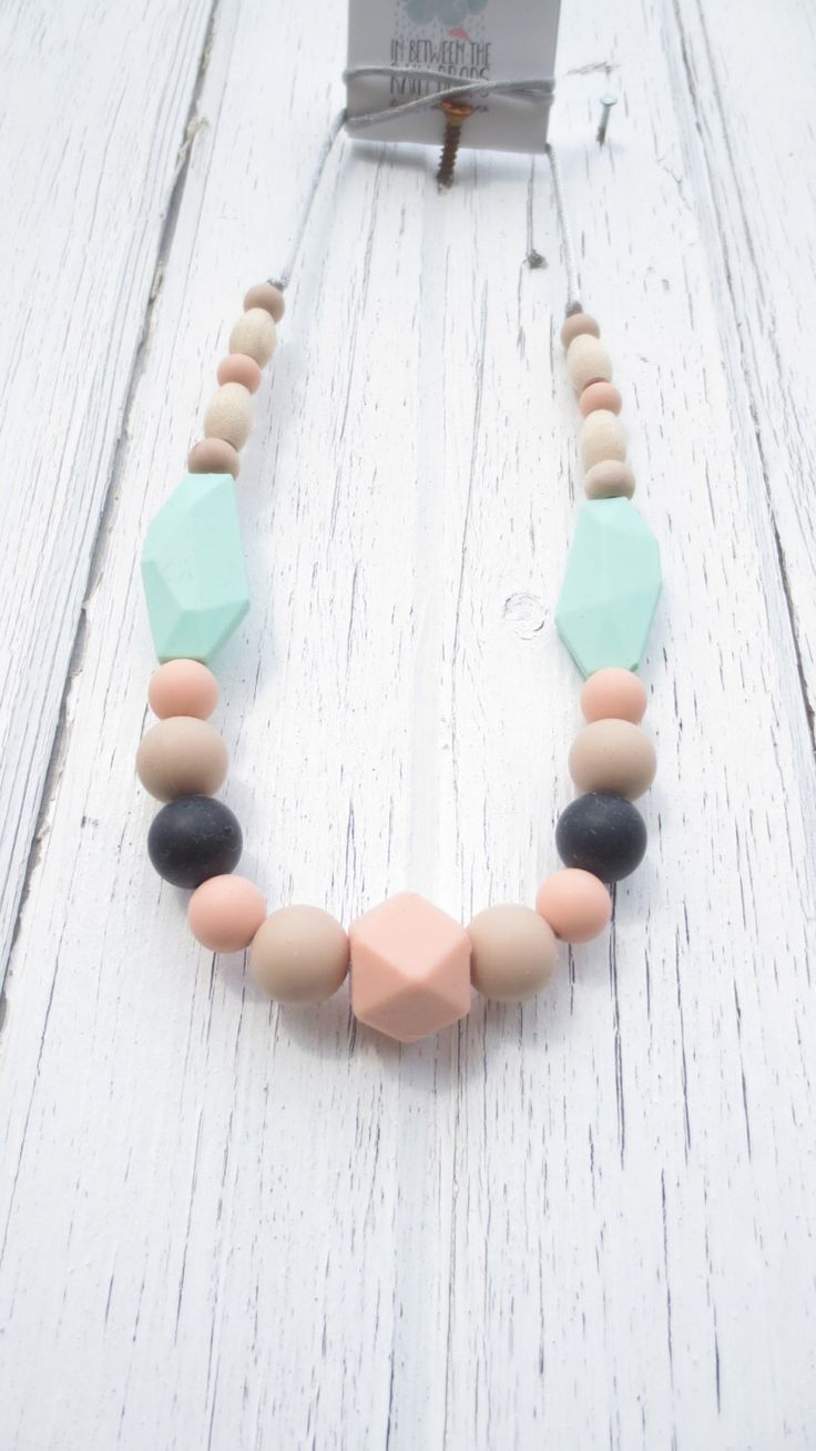 A personal favorite from my Etsy shop https://www.etsy.com/ca/listing/217575908/beads-silicone-teething-necklace-maple