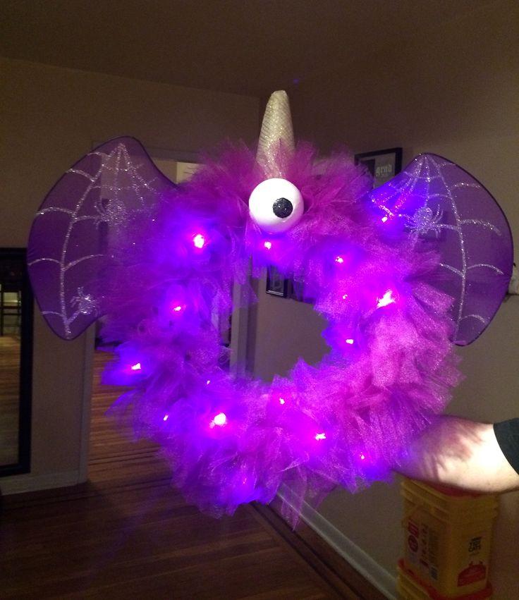 One Eyed One Horn Flying Purple People Eater Halloween Wreath.  http://hoosierhomemade.com/halloween-monster-wreath-purple-people-eater-tutorial/