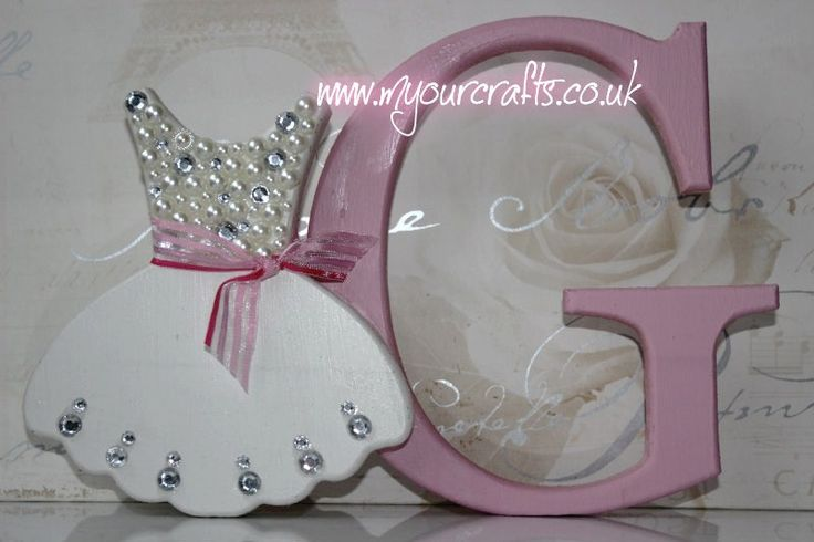 Wooden crafts. Bespoke mdf freestanding letter with Bag attached. Nursery or baby girl rooms decor. A keepsake gift for baby girl. Other craft shapes available for baby boy. Available at www.myourcrafts.co.uk