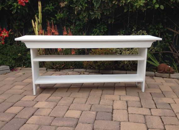 This TV Stand is 60 inches long, 14 1/2 inches wide, 22 inches tall and made of solid pine. Shown here in antique white without any