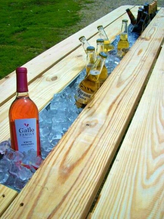 Replace a board of picnic table with rain gutter to create cooler. So cool!