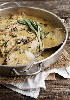 Pork Loin with Wine and Herb Gravy - pork loin cooked with wine and rosemary and sage, then sliced and served with a delicious, lightly creamy gravy.