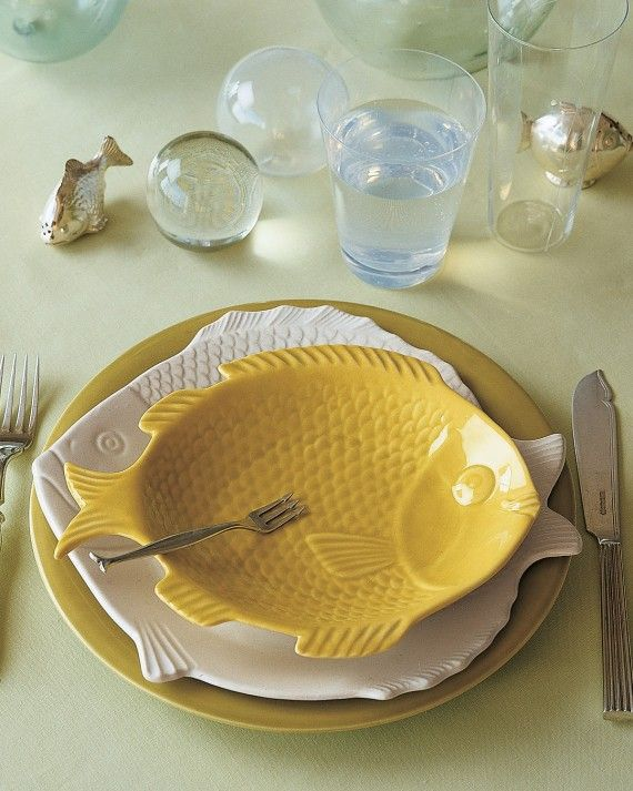 A close-up of the ceramic fish place setting.