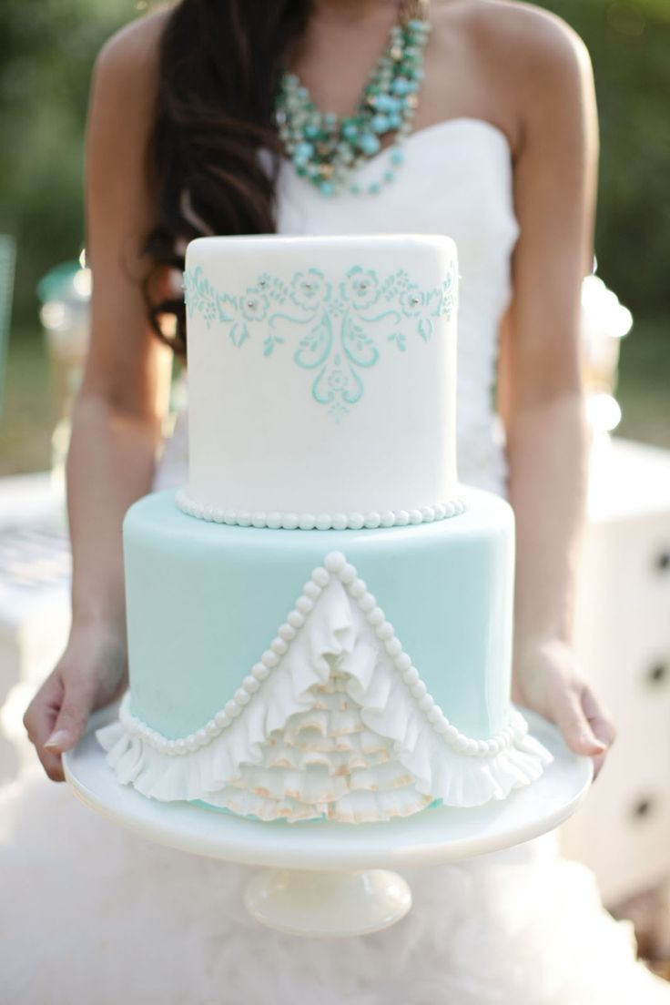 An aqua wedding cake - with stunning details in the icing.