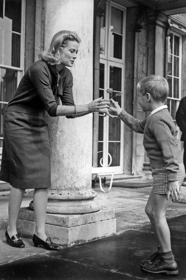 Princess Grace playing games with her son, Prince Albert, 1963
