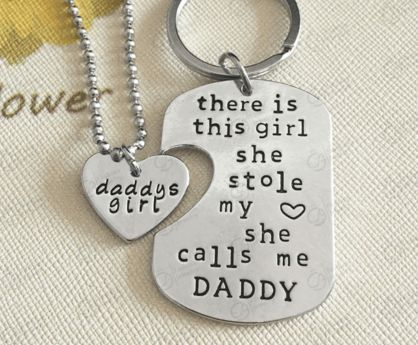 """""""There Is This Girl She Calls Me Daddy"""" interlocking pendant set makes a great gift. Want to tell your daughter how much she means to you? This necklace says it all! Necklace Type: Chain Necklaces/key"""