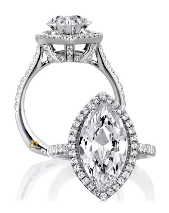 LOVE marquise shaped diamonds!    From the Heritage Collection, this beautifully crafted Marque shaped halo engagement ring has .73ctw round side diamonds, set in 18K white gold.