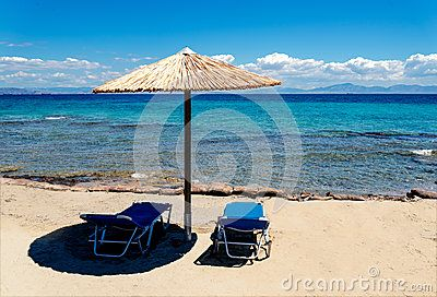 Beach landscape with umbrella straw on the blue sea