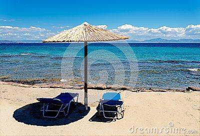 Beach landscape with umbrella straw on the blue sea