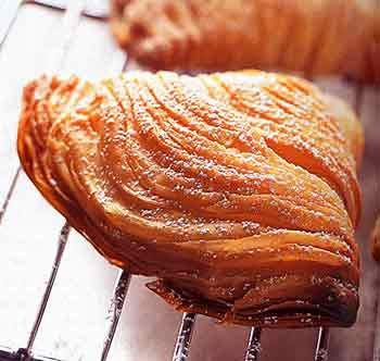 Sfogliatelle! The best pastry I have ever eaten. Only place I've found them was at a very small bakery in Atlantic City, NJ about 13 years ago. So good that they just might be worth a trip to New Jersey. Ricotta-Filled Pastries Recipe at Epicurious.com