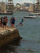 Australia Day kids jumping into the sea in Sydney Harbour, Ships flocking the harbour