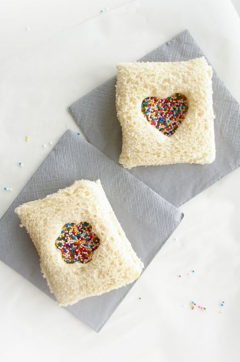 Fairy bread- -cut the crusts off the bread then on one piece spread butter/chocolate spread. Use a cookie cutter to make a hole in the other and then put together. This would be really cute for a tea party! :)