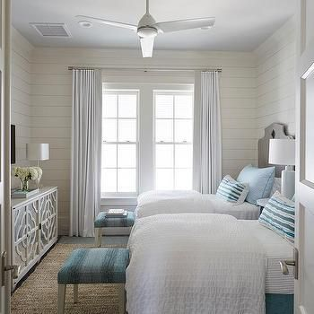 Gray and Blue Beach Style Bedroom with Gray Quatrefoil Mirrored Cabinet