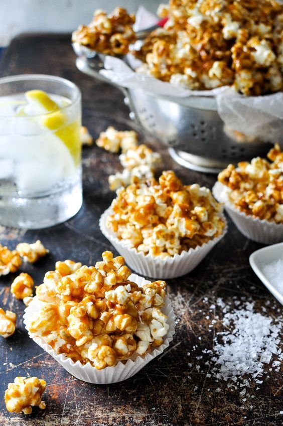 Salted Caramel Popcorn - great party food! Easy and fast to make and keeps well for a 2 to 3 days. Use muffin tin casings to make individual servings!
