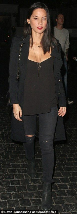 Olivia-Munn-bewitching-tattered-jeans-slick-deep-red-lipstick-leaves-Chateau-Marmont