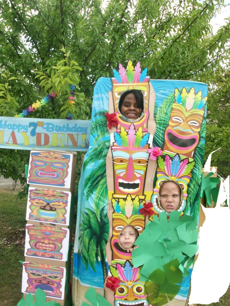 Hawaiian Luau DIY Tiki- Totem Pole-- Large tall box with a step ladder for the top face to stand on- Dollar store backdrop mask cutouts and paper leaves complete the pole. http://kraftpaperqueen.com/paper-crafts/