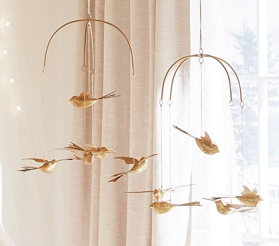 GOLD BIRD MOBILE | Handmade birds with gold glitter detail fly overhead and bring chic style to their nursery or bedroom. @potterybarnkids