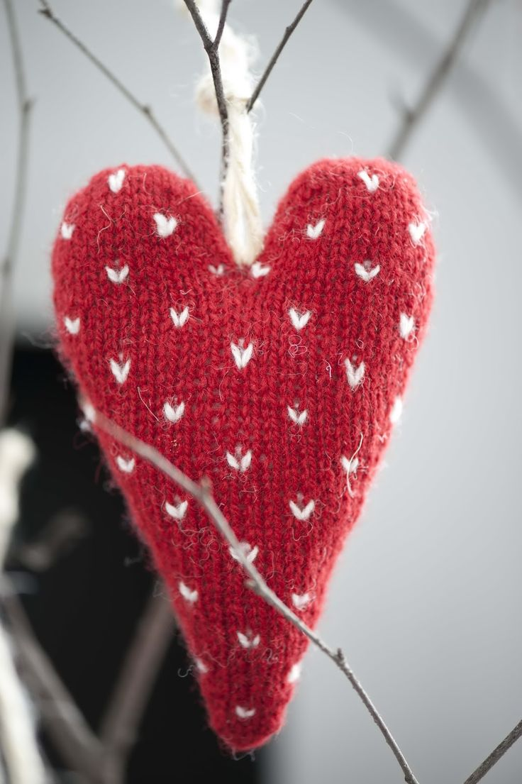 Knitted red and white heart ornament