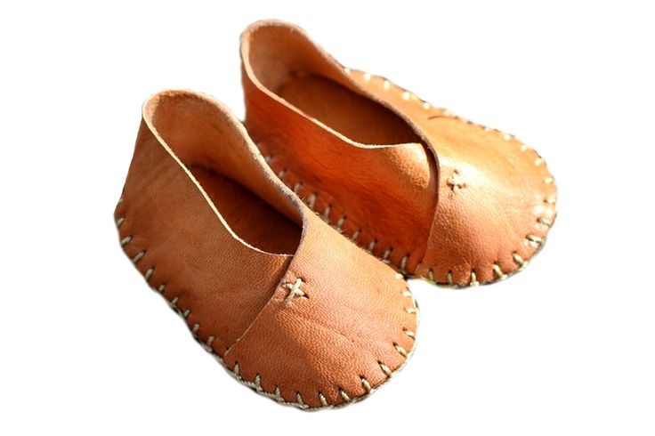 Leather for Littles Made from local goat leather in Gonaives, Haiti, these booties would make a lovely gift for a little one. The soft leather is hand-stitched with care into three sizes—large, medium