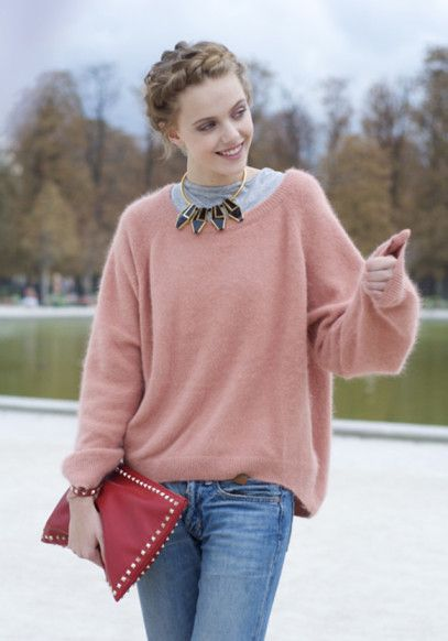 Frida Gustavsson Paris Fashion Week. Pink cashmere sweater, collar shirt, and braided up do, with pants.