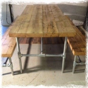 reclaimed scaffold board and galvanised metal pipe trestle table and matching benches. ww.wingsuk.co.uk