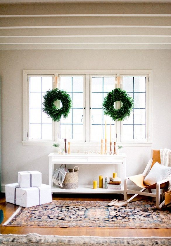 Modern eclectic holiday decor with wreaths in window