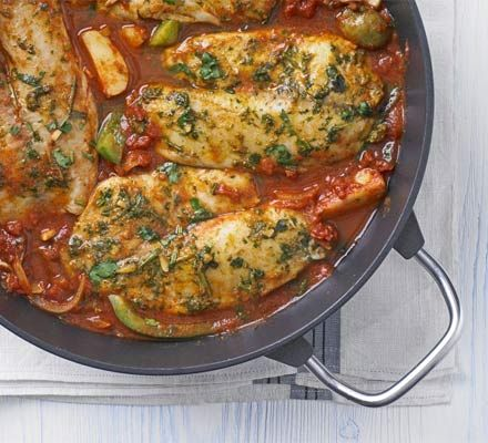 Fragrant Fish Tagine With Olive Oil, Garlic Cloves, Ground Cumin, Paprika, Coriander, Salt, Lemon, Tilapia Fillets, Olive Oil, Onions, Garlic Cloves, Ground Cumin, Paprika, Chopped Tomatoes, Fish Stock, Pimentos, Green Pepper, New Potatoes