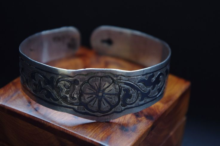 A BELOVED TREASURE from the Caucasus: old handmade Russian Caucasian Georgian niello bracelet, unusual closure and lovely floral decoration by GlobalAdornments on Etsy https://www.etsy.com/listing/251696416/a-beloved-treasure-from-the-caucasus-old