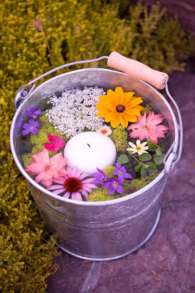 Garden Party Ideas Pinterest secret garden party Decorate For An Evening Garden Party By Placing Buckets Of Floating Candles And Flowers Around The