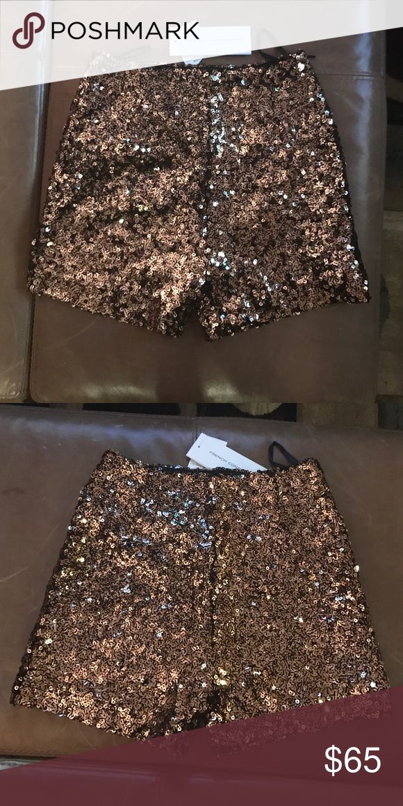French Connection sparkle gold shorts Cosmic Sparkle Hot Pant shorts by French Connection. High waisted design featuring all over sequin embellishment. Tags still attached item has never be worn. French Connection Shorts