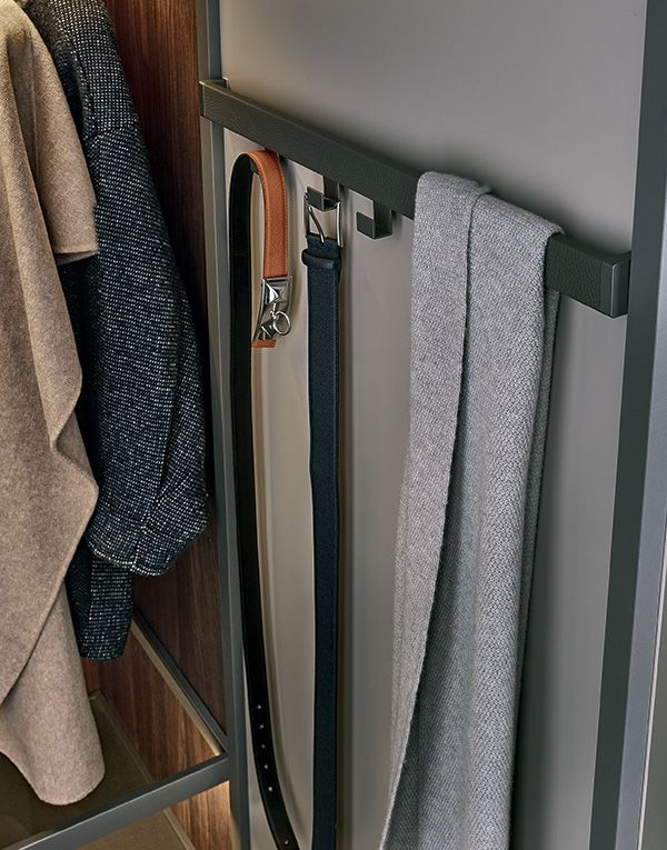 Back of Fitted door with piombo painted aluminium frame, bar covered in techno-leather with belt hooks.