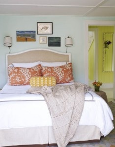 Master bedroom. farmhouse meets eclectic.    linen bedskirt, white duvet, muted orange pillows