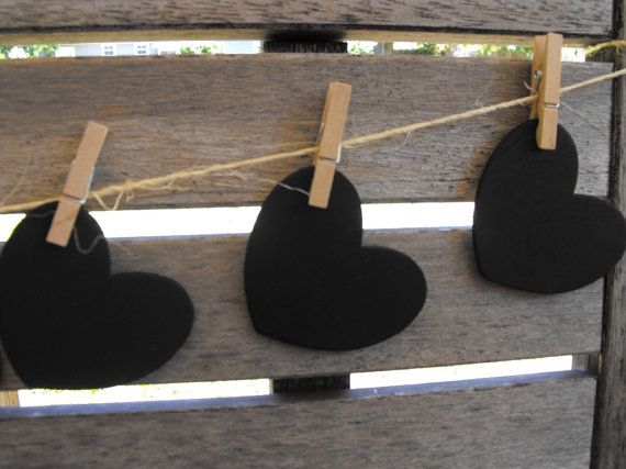 mini blackboards or heart chalkboards pegged to twine as escort cards.