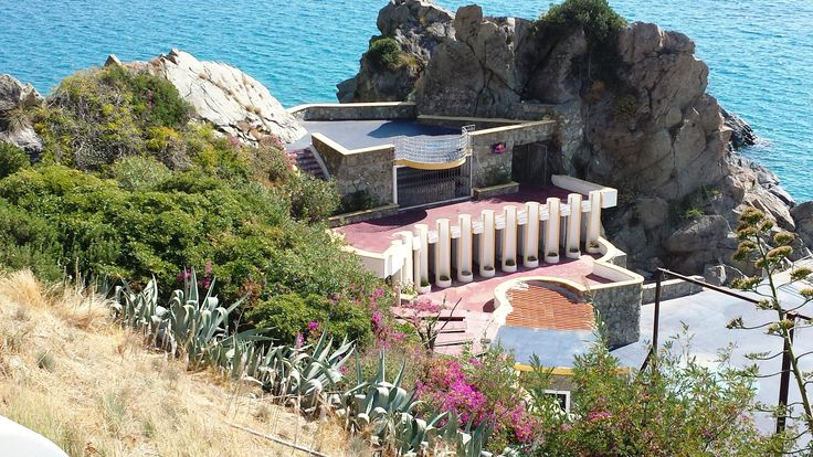 This is some sort of restaurant, bar, night club or disco that is open during the tourist season.  It is right on the beach up against a large rock that people climb and jump off of into the water.  Caminia of Staletti, in the Calabria region of Southern Italy.