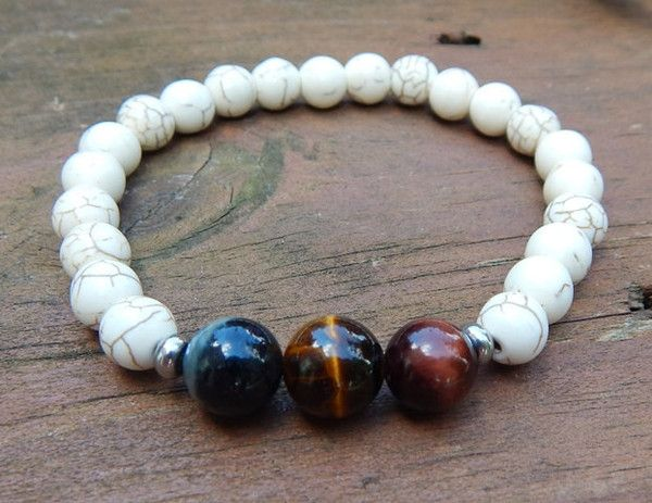 This men's bracelet is made with three Tiger Eyes, yellow, red and blue surrounded byHowlite. Very cool. Mens Gemstone Bracelet Mens White Bracelet Men Bracelets