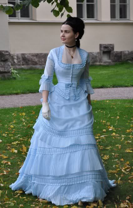This lady is an AMAZING seamstress!!!! This dress was inspired by the painting, Conservatory and Bunch of Lilacs by Tissot. From what I can tell from her blog, she recreates these dresses from 18th and 19th century paintings!
