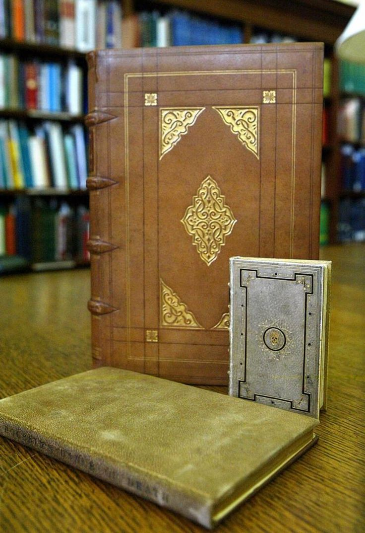 three books covered in human skin at the John Hay Library at Brown University in Providence R.I.  The Bigger one is 'De Humani Corporis Fabrica', a 16th century book on human anatomy. The smaller one is Hans Holbein's 'Dance of Death', binding by Cox    (JOE GIBLIN/AP)