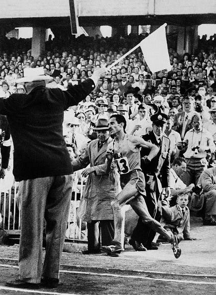 French champion Alain Mimoun runs the marathon event December 01 1956 at the…