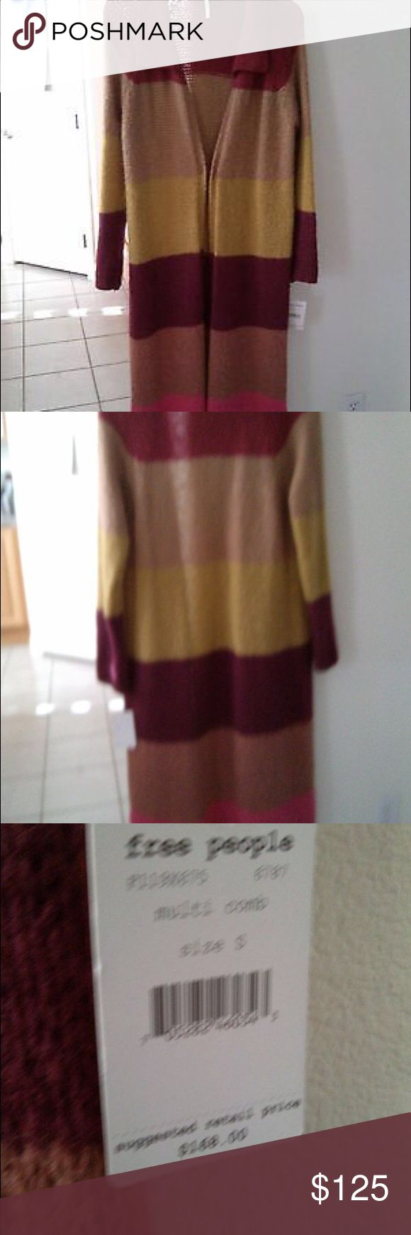 NWT free people colorblock long cardigan small This brand new Free People coat sweater is sold at department store for $168.00. It is in perfection condition, it has multi color: red, beige, yellow, brown and pink.  Measurement: L=43.5, armpit to armpit =17, Sleeve= 24 and sleeve opening= 4 inches. Free People Sweaters Cardigans