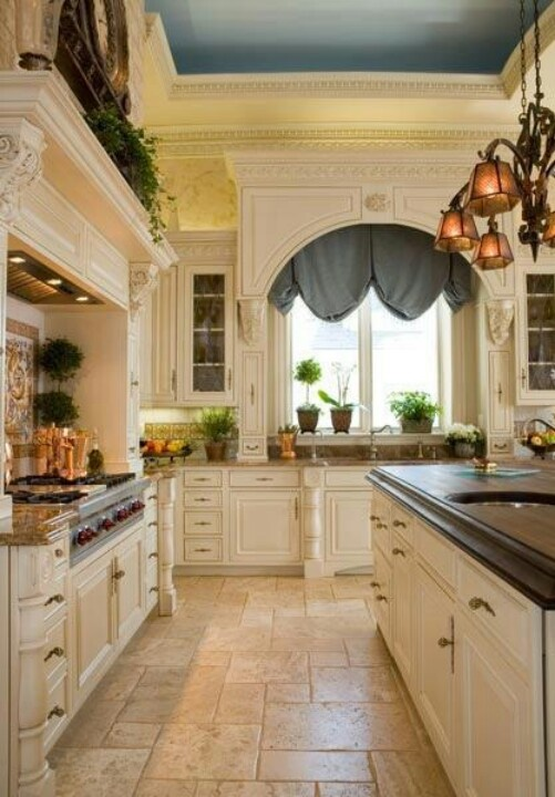 Elegant kitchens - love the ceiling, cabinetry, and the plant window