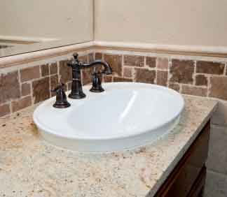 Bathroom Granite Countertop With Mosaic Tile As Back Splash The Porcelain Sink