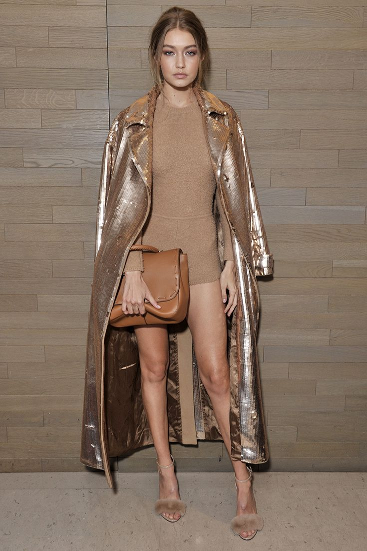 Gigi Hadid upping her bronze goddess status at a Max Mara event at Milan Fashion Week. Shades of camel, brown and tan = one-colour dressing nailed