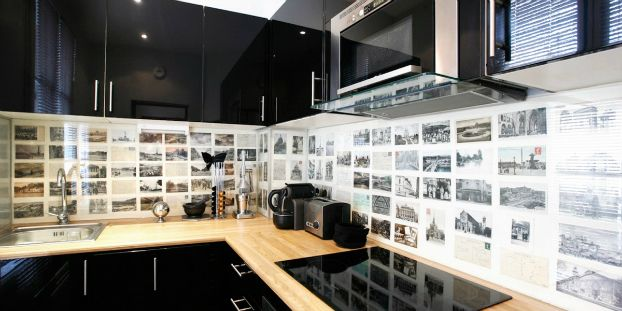 Photos behind glass make for a personal style splash back. Ideas for photo themes include history, architecture, people and pets. Colour or black or white themes would change the effect also.