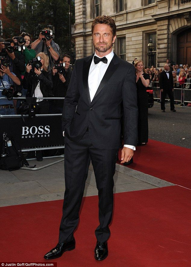 Suits you sir: Gerard Butler leads the dapper gents arriving at the GQ Awards in London on Tuesday night September 2, 2014