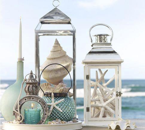 summer decor.   Shells in lanterns